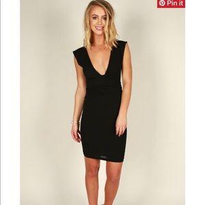 Dresses & Skirts - Impressions boutique black low cut dress